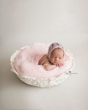 newborn-baby-girl-photo-prop-bowl-wrap-bonnet-posing-europe