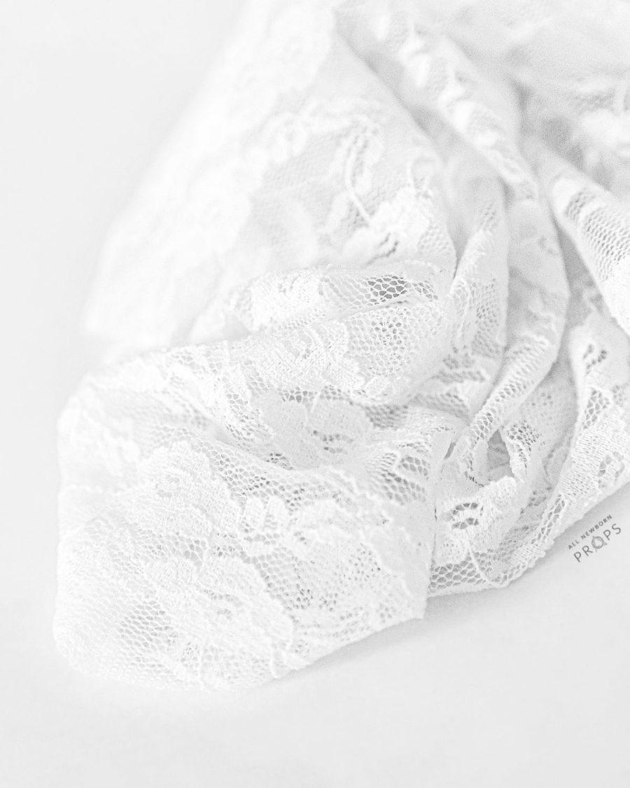 newborn-wrap-phorography-prop-girl-swaddle-lace-stretch-white-photoshoot-europe