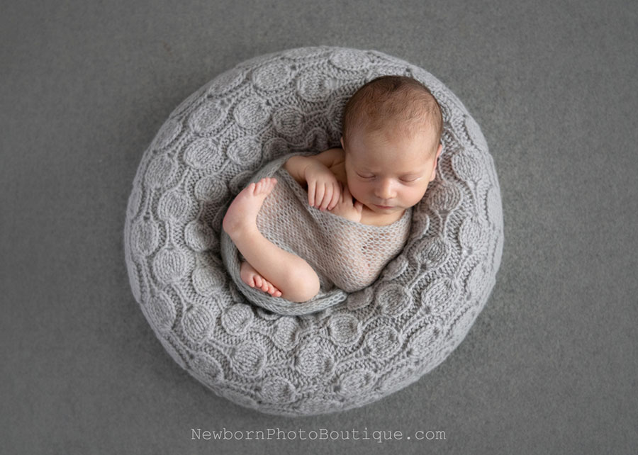 newborn photoshoot ideas baby boy posing ring wrap photography prop