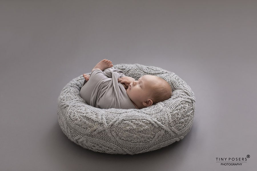 newborn-photography-sets-boy-posing-pillow-wrap-grey-new-born-props-europe